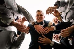 Florida groomsmen throwing the groom Wedding Photographers Tampa