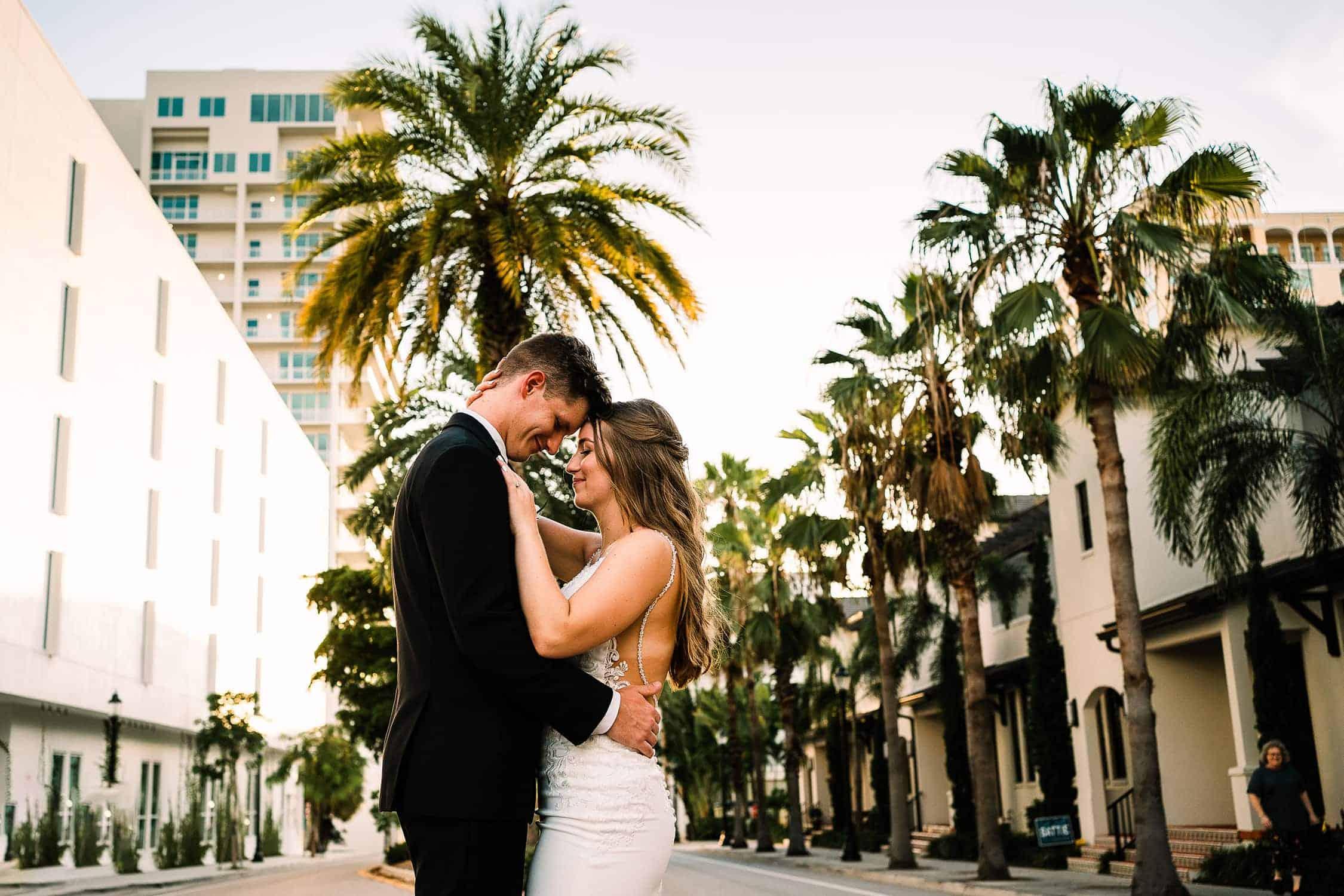 Couple hugging at a wedding in the Sarasota Modern by Sarasota wedding photographer