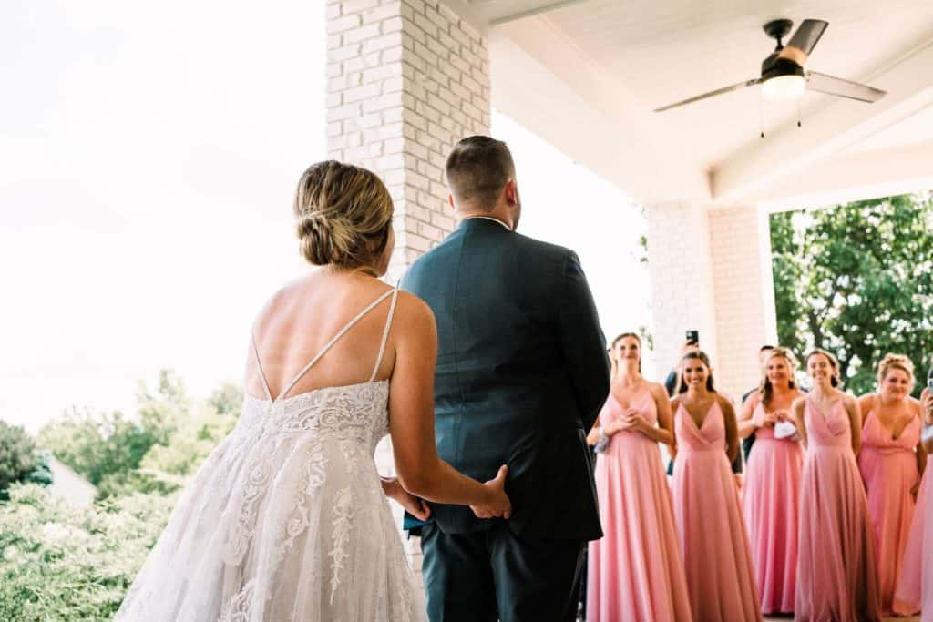 Funny bride grabs grooms butt during the first look