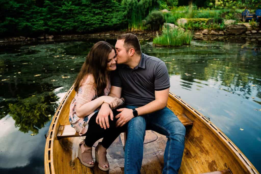 couple on canoe during northern indiana engagement session
