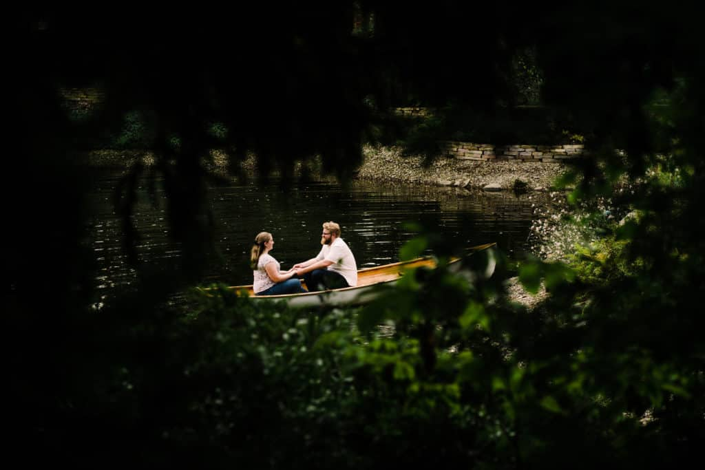 Couple on boat Hamstra Gardens engagement session