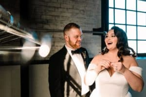 Couple Laughing at reception at the Brick near St. Joseph River