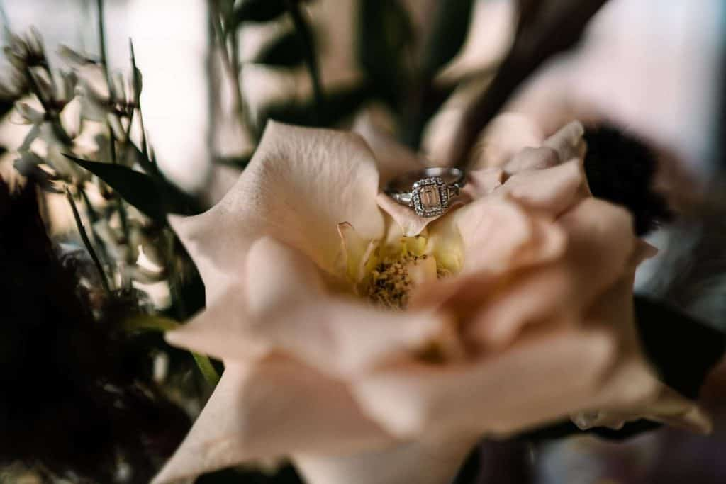 wedding day details: wedding ring and flowers