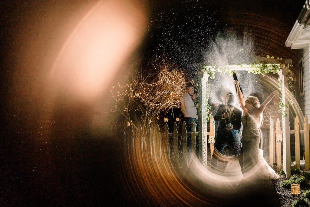 wedding reception champagne spray send off photograph