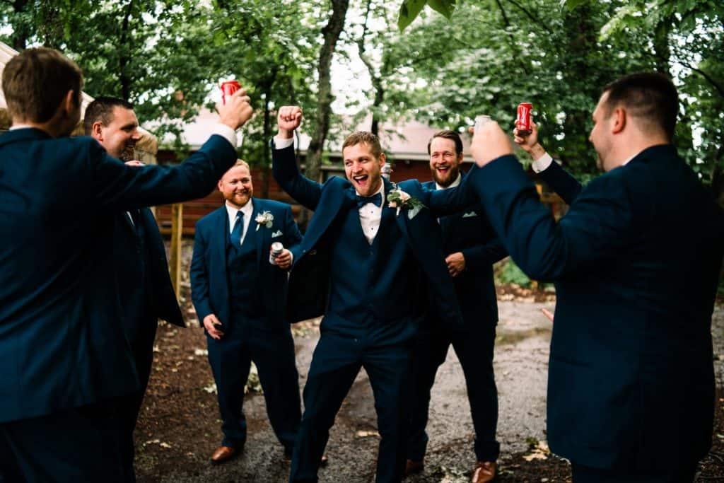 groomsmen having fun together on a wedding day
